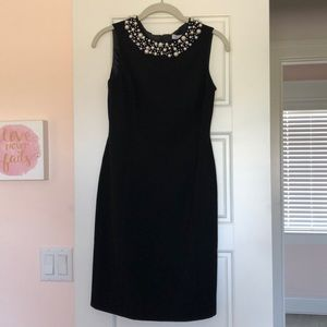 Black cocktail dress with pearl trim at neckline